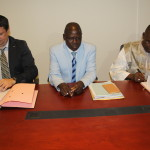 Ph/DR-: Les deux parties signant les documents consacrant le partenariat pour la construction de centre de traitement du cancer (de la gauche vers la droite) : Loïc ARCHIVOLTI du Groupe UNTEC ; Antoine DOMAH, Ministre de la Santé et  Fulbert AMOUSSOUGA GERO, Ministre d'Etat OMD- ODD et des Grands Travaux